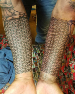 hollis-cantrell-iconic-tattoo-ink-piercing-chain-mail-lines-peoria