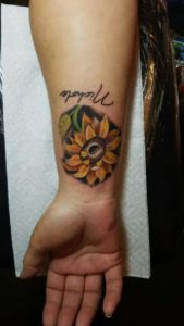 small-hollis-cantrell-iconic-tattoo-ink-piercing-sunflower-color-name
